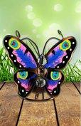 Vlinder koper look met pauwen oog vleugels.
