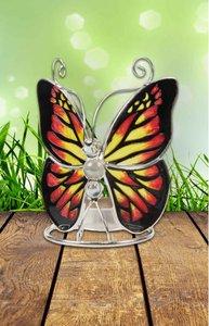 Geel, rood, zwarte vlinder met wax licht.