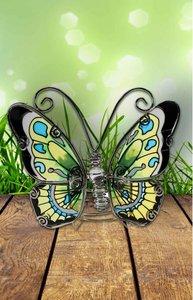 Vlinder, geel, groen blauw en zwart.